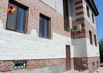 Дом без отделки декоративным камнем