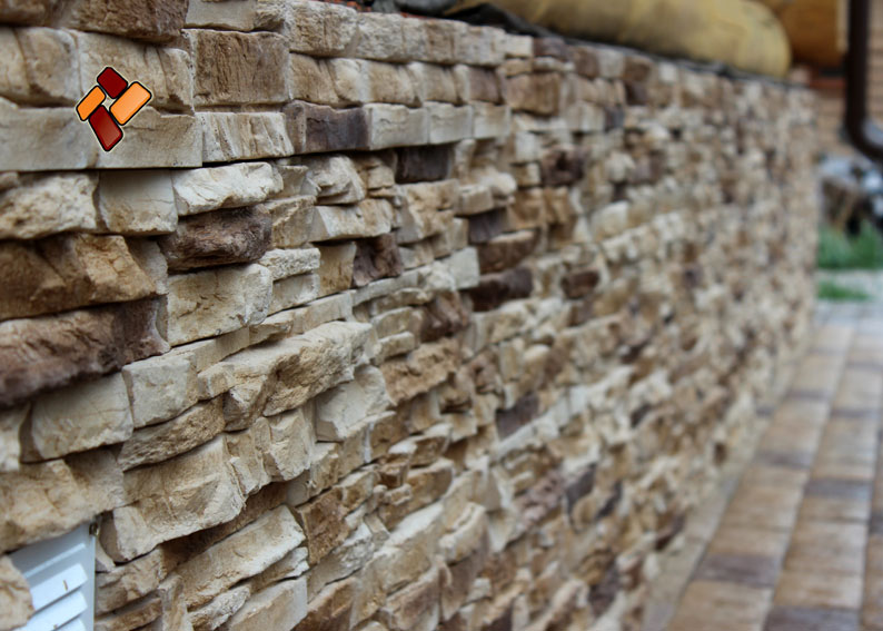 Technology of facing a wooden house with manufactured stone veneer